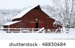 Big red barn in the snow - stock photo