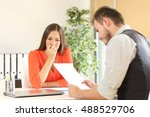 Stock photo nervous woman looking at manager reading her resume during a job interview at office 488529706