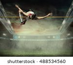 athlete in action of high jump.   Shutterstock . vector #488534560