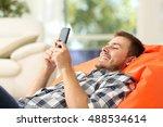 relaxed man using a smart phone ...   Shutterstock . vector #488534614