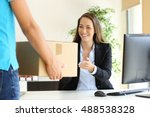 happy businesswoman receiving a ... | Shutterstock . vector #488538328