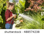 Beautiful Young Woman Watering...