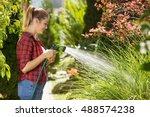 Beautiful Young Woman Watering...