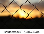 sunset and wire | Shutterstock . vector #488626606