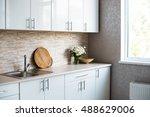 Stock photo interior of new bright white home kitchen 488629006