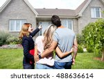 Small photo of Real Estate agent woman with clients near new house.