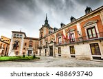 Madrid, Spain. A picturesque small square in the heart of Spanish capital city with City Hall. Oldest civil square in Madrid, cloudy day landscape.