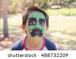 young boy with fun green and... | Shutterstock . vector #488732209