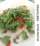 Small photo of Abruptness with tomatoes and arugula.