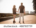 couple from behind holding... | Shutterstock . vector #488785759