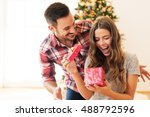 Man giving a Christmas present to his girlfriend - stock photo