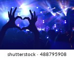 festival crowd raising hands in ... | Shutterstock . vector #488795908