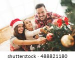 family decorating a christmas... | Shutterstock . vector #488821180