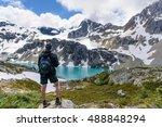 hiker standing on a rock... | Shutterstock . vector #488848294