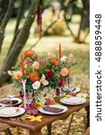 wedding dinner in a garden. | Shutterstock . vector #488859448