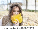 young woman covering face with... | Shutterstock . vector #488867494