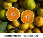 One Tangerine Cut In Two...