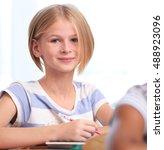 cute schoolgirl on lesson in... | Shutterstock . vector #488923096