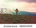 hiking man in the mountains | Shutterstock . vector #488944909