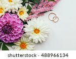 wedding rings and a colorful... | Shutterstock . vector #488966134