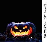 halloween pumpkin and  candle... | Shutterstock . vector #489003784