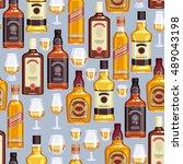 whisky bottles and glasses... | Shutterstock .eps vector #489043198