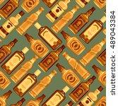 whisky bottles seamless pattern ... | Shutterstock .eps vector #489043384