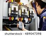 technician is measuring voltage ... | Shutterstock . vector #489047398