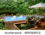 Small photo of Backyard with pool after a afternoon downpour.