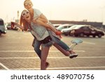 girls have fun in parking with... | Shutterstock . vector #489070756