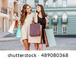 happy young women with shopping ... | Shutterstock . vector #489080368