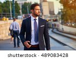 a handsome young businessman... | Shutterstock . vector #489083428