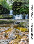 Small photo of Ddwl Isaf waterfall (Lower Gushing Fall) on the Nedd Fechan River along the Elidir trail in South Wales UK