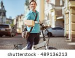 cheerful delighted courier... | Shutterstock . vector #489136213