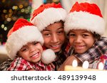Three Kids In Christmas Hats....