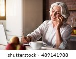 old woman talking on the phone... | Shutterstock . vector #489141988