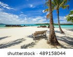 deck chairs under palm trees on ... | Shutterstock . vector #489158044