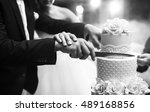 a bride and a groom is cutting... | Shutterstock . vector #489168856