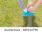 mother tying shoes to her... | Shutterstock . vector #489214798