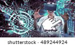 woman using a virtual reality... | Shutterstock . vector #489244924