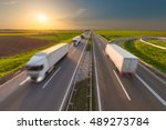 many delivery trucks driving... | Shutterstock . vector #489273784