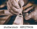 hands carpenter  measuring work. | Shutterstock . vector #489279436
