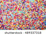 festive background of confetti | Shutterstock . vector #489337318