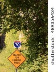 Small photo of Trail along the Missouri River with a sign warning about falling rocks