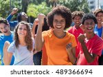 large group of cheering young... | Shutterstock . vector #489366694