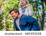 young couple in love hugging... | Shutterstock . vector #489393358