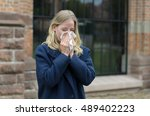 sick young woman blowing her... | Shutterstock . vector #489402223