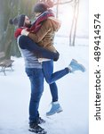 lovely couple and winter season | Shutterstock . vector #489414574