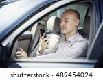 businessman driving and talking ... | Shutterstock . vector #489454024