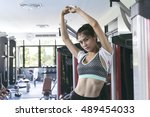 young woman making exercise... | Shutterstock . vector #489454033